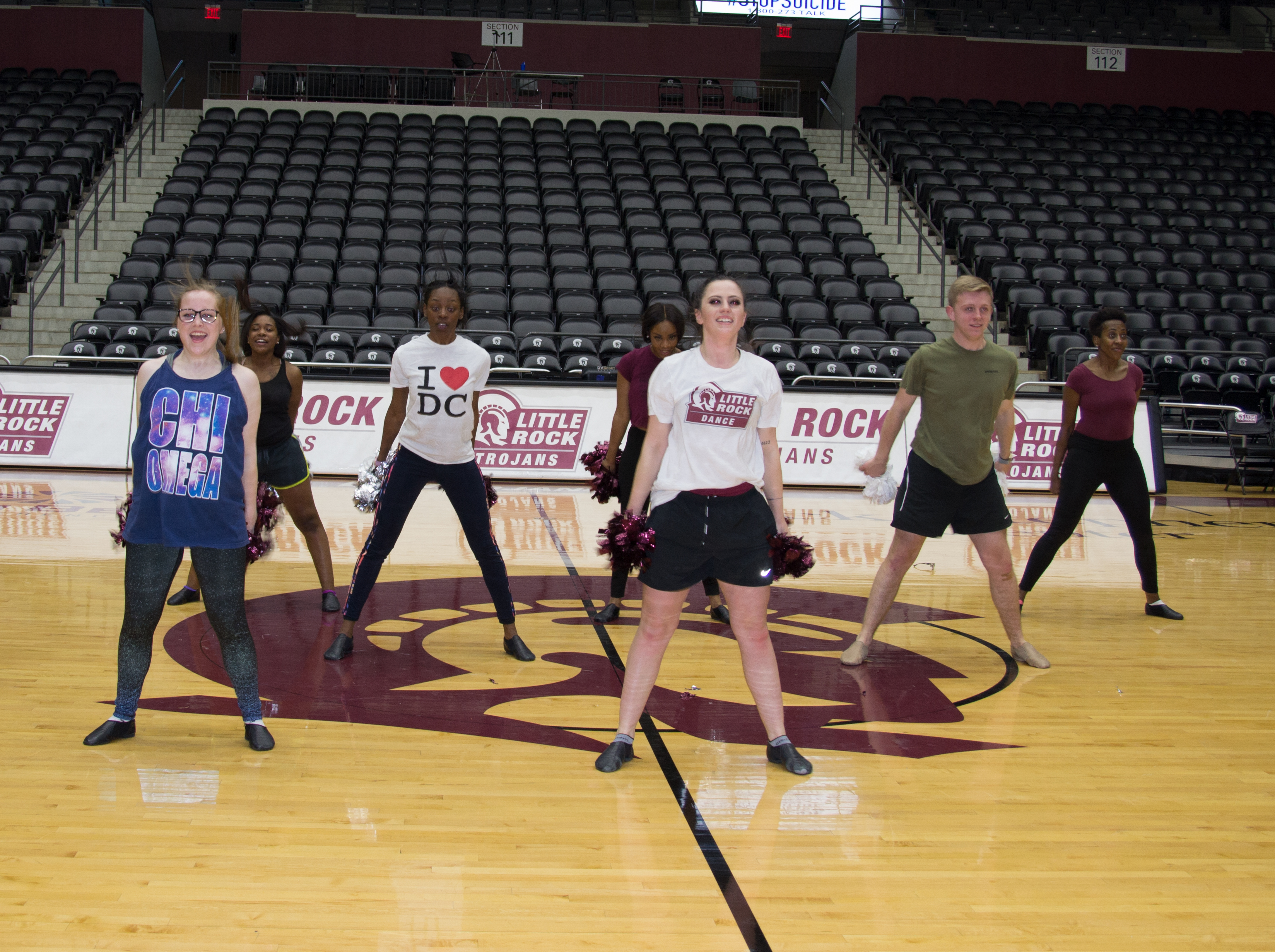 UA Little Rock dance team members shows excitement as they start their routine.