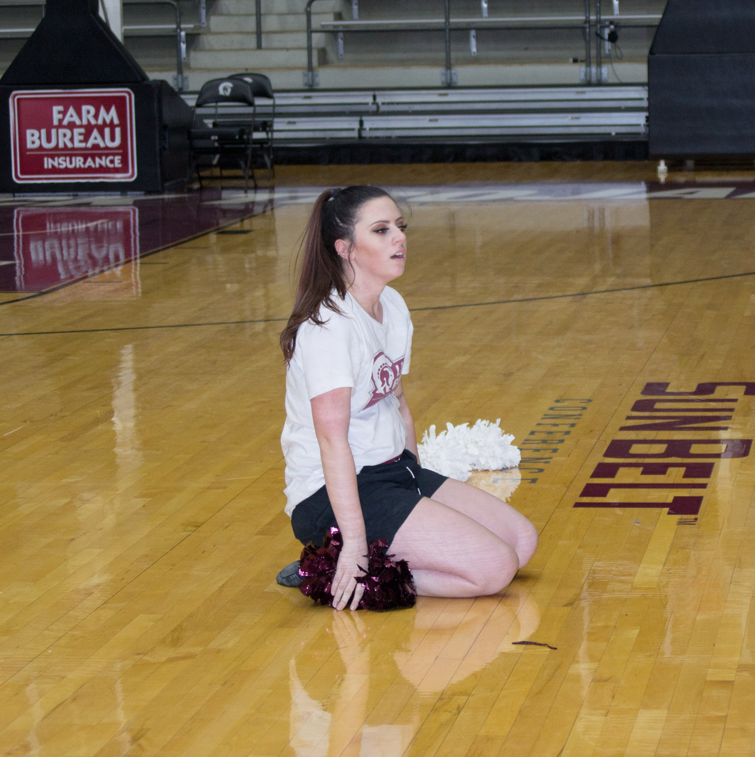 UA Little Rock student-athlete Jayme Rash takes a breather after practicing dance routine.