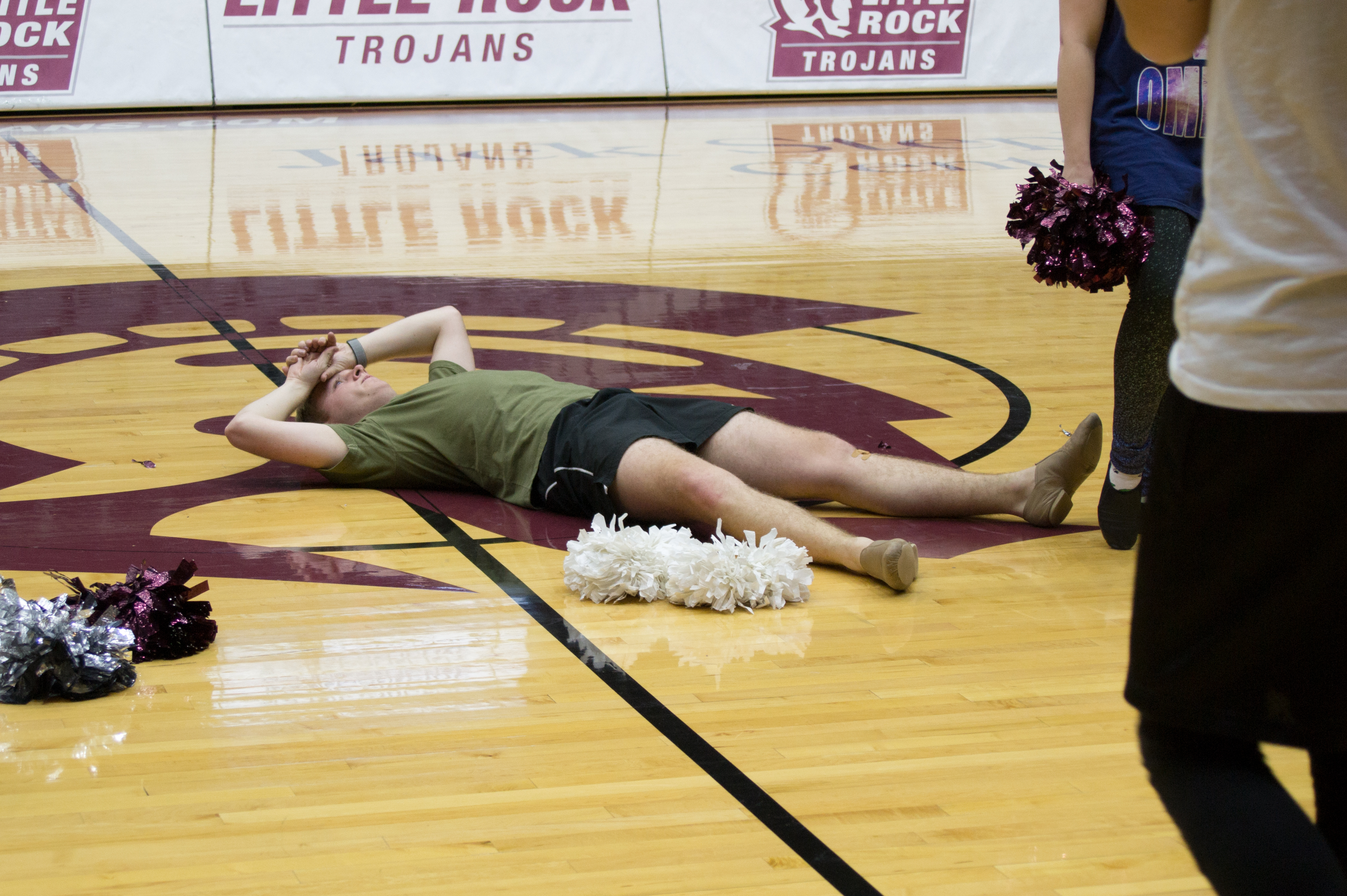 UA Little Rock dance team leader Christopher Gardner exhausted after a night of practicing Sun Belt Conference routine.
