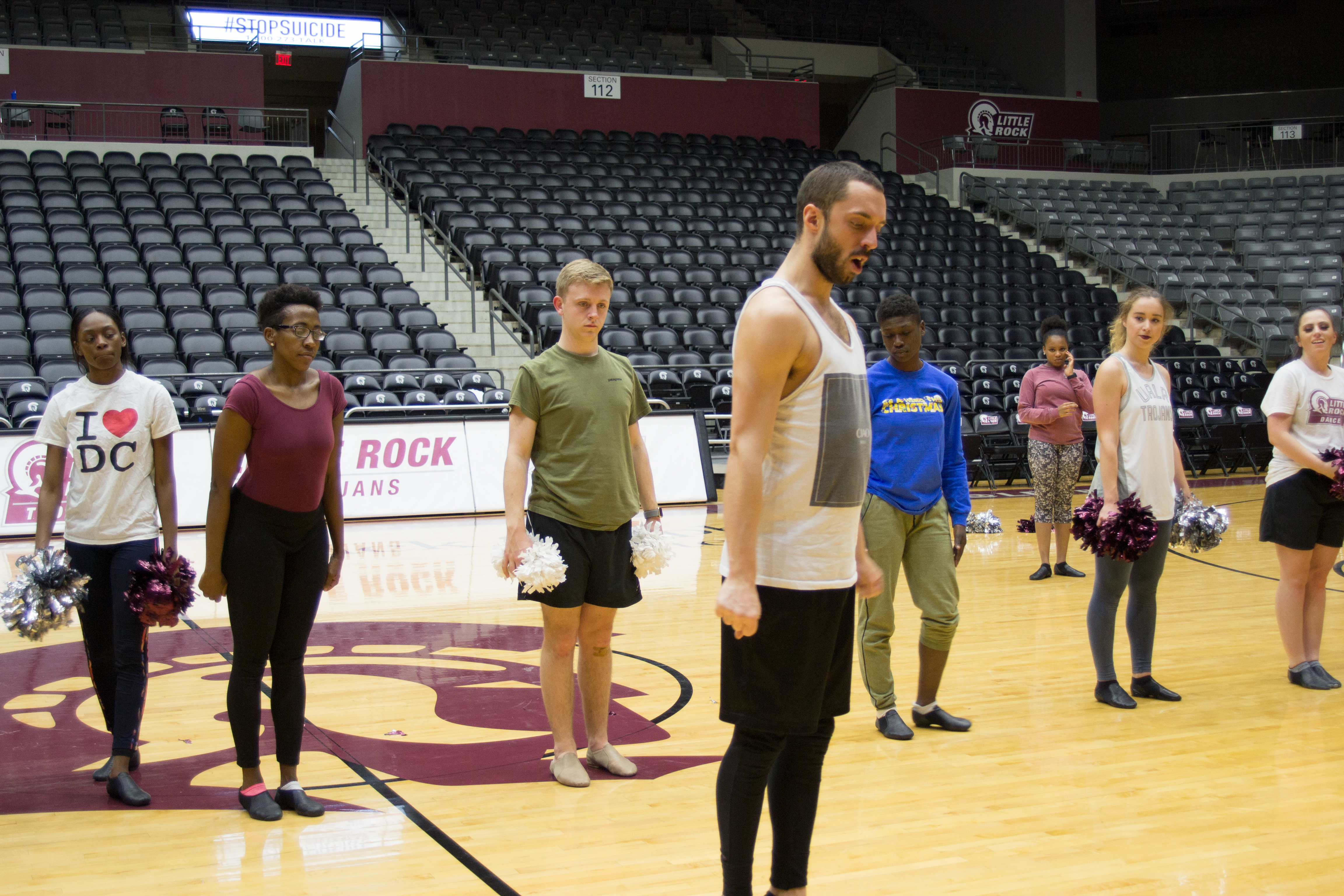 UA Little Rock Dance Coach Cameron Kuhn practice routine with his team.